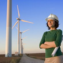 Engineer Stands In Front of Wind Turbines