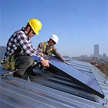 Workers Install Solar Panels